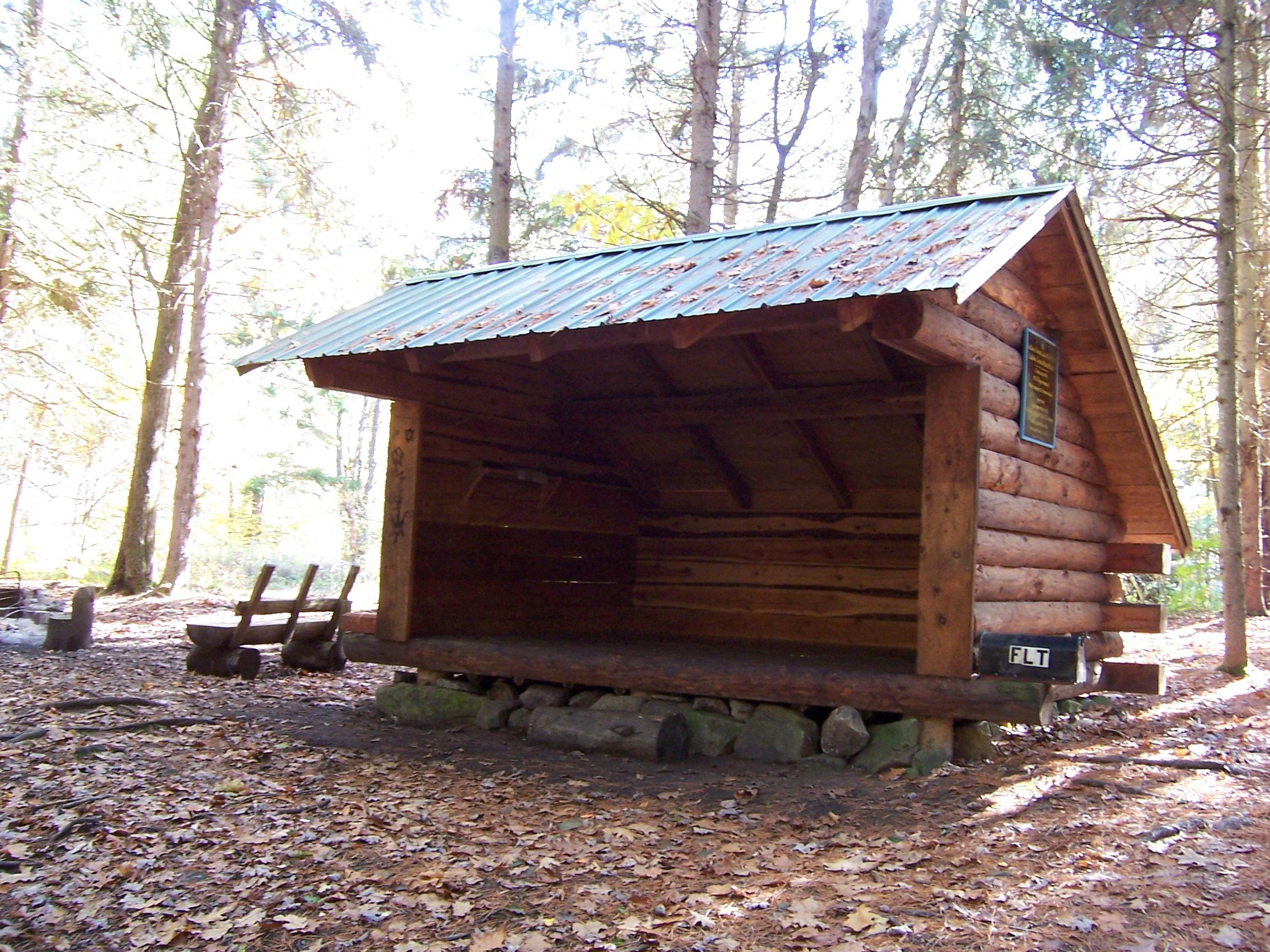Log Lean To Http://www.cnyhiking.com/FLT LudlowCreekStateForest.htm. Full resolution  portrait, nominally Width 2304 Height 1728 pixels, portrait with #41698A.